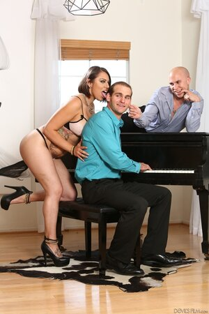 Young woman can't stop enjoying piano player and tempts him together with hubby