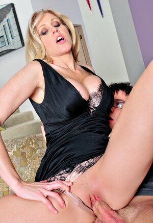 Alone blonde cougar gladly shares sexual experience with stepson's nerdy pal