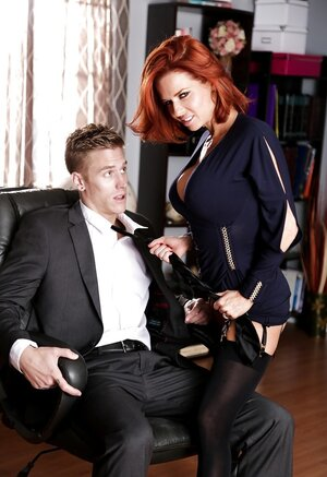 Tall office worker and besides red-haired boss with big boobs make out in cabinet