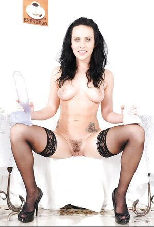 Pale-skinned brunette not afraid to place soaked cunny on top of big dildo