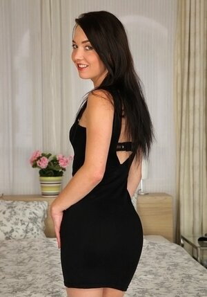Erotically attractive black dress of European gal hides from landlord an attractive body