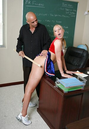 Shaved teacher uses a ruler to punish blonde cheerleader and enjoys fellation
