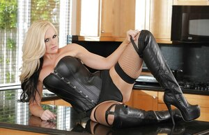Blonde Eager mom Alena Croft in a leather corset and besides high heels poses in the morning