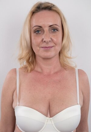 Dirty old woman has saggy titties and besides belly but still poses naked in studio