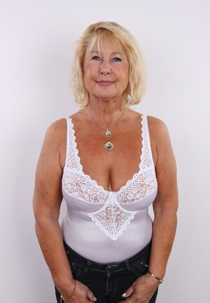 Old diva shamelessly shows off saggy natural titties and moreover bushy pussy
