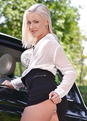 Gorgeous diva got a brand-new car and poses by it as a professional porn model