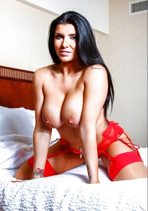 Hot big-boobied brunette wears red underwear just to tempts fellas taking it off