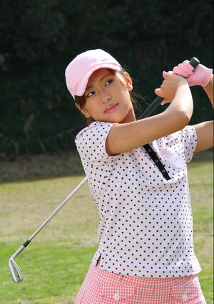 Asiatic golf girl wears shirt and skirt but dislikes panties and flashes muff